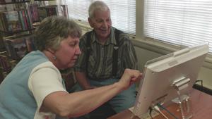 Telikin Cares recipients at computer