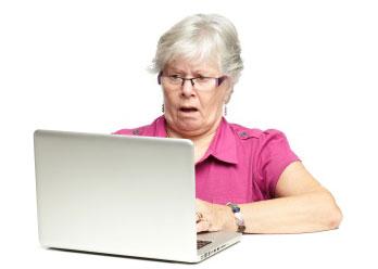 shocked senior computer user